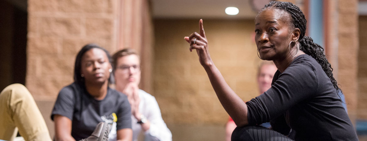 Activist Sonja Parks speaks with student actors performing the play 'Raisin in the Sun'