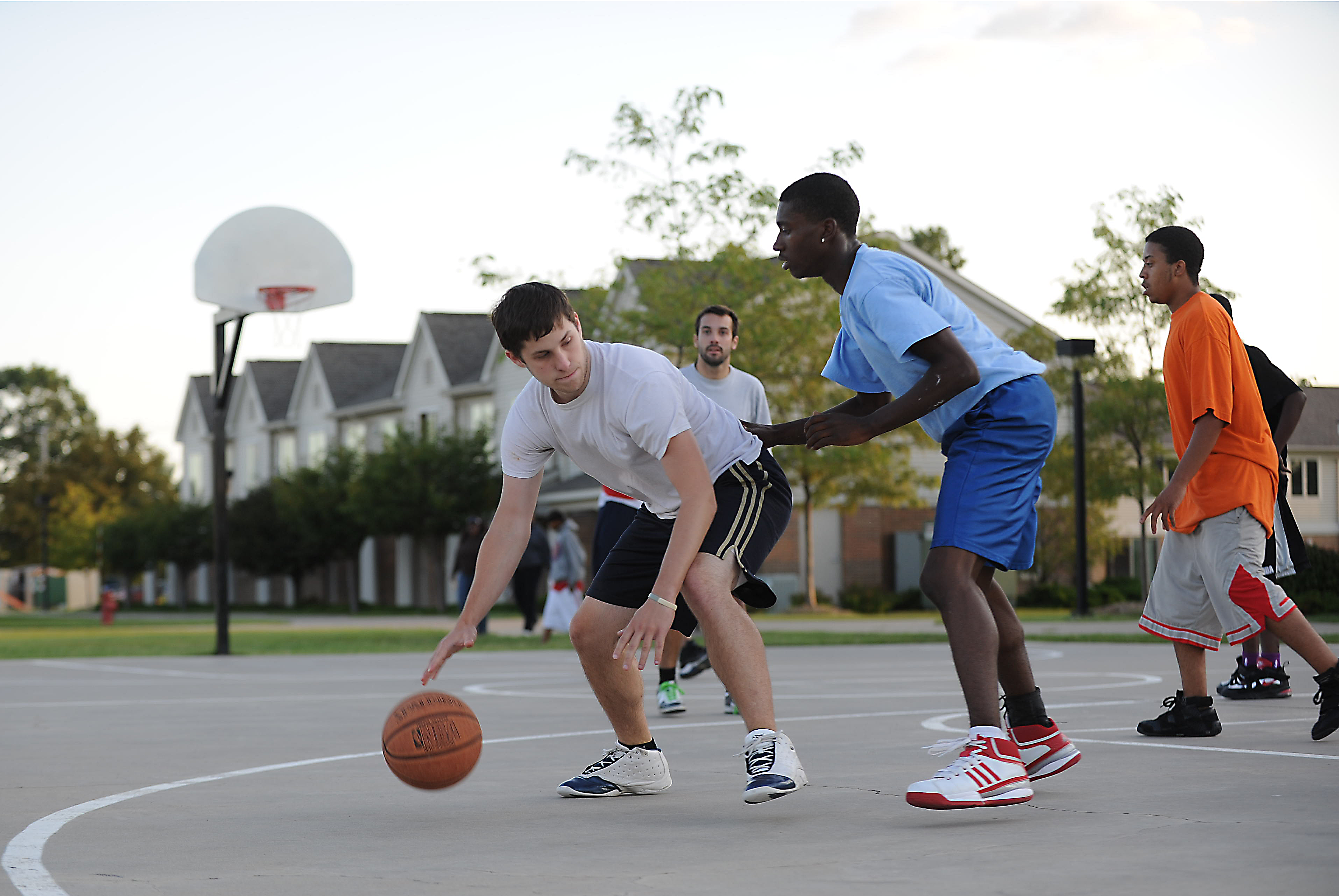 Freshmen students playing basketball.
