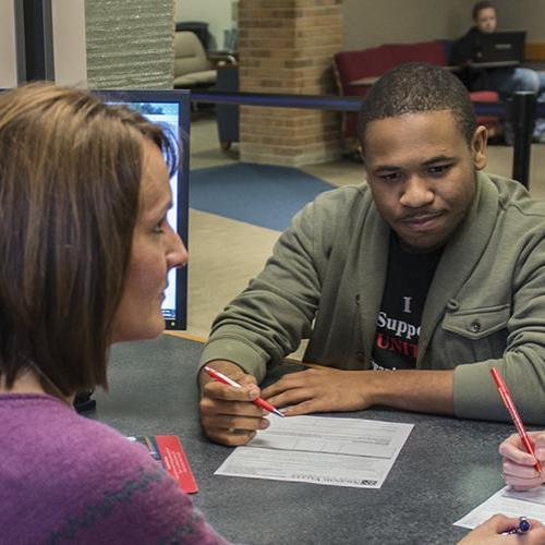 Students getting assistance with financial aid