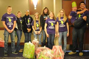 Youth Leadership students wrap Christmas gifts for the less fortunate.