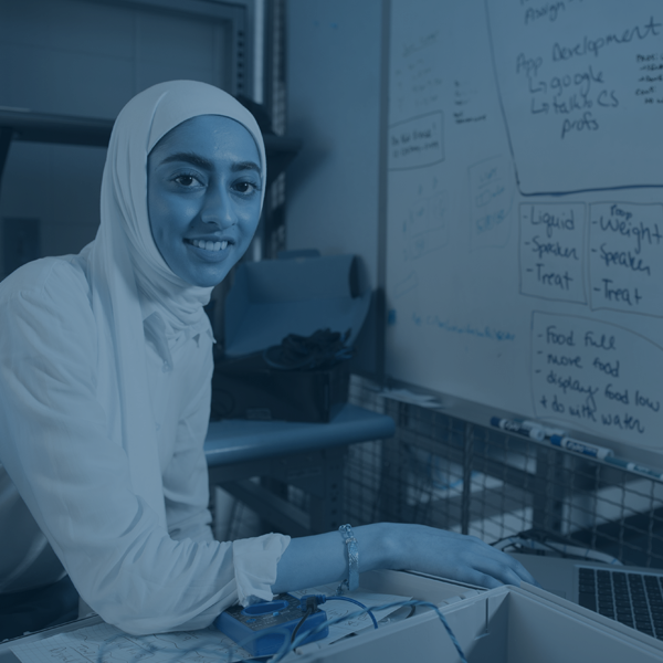 female electrical engineering student working in front of whiteboard