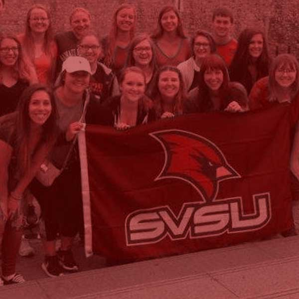 History group with svsu cardinal flag