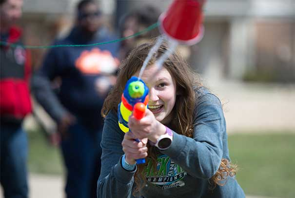 students playing water gun games at the UVs