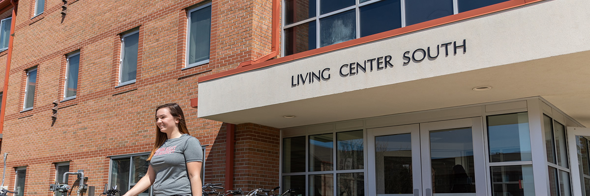 Living Center South with student walking