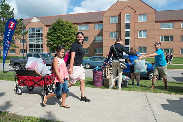 Students moving in to the dorms.