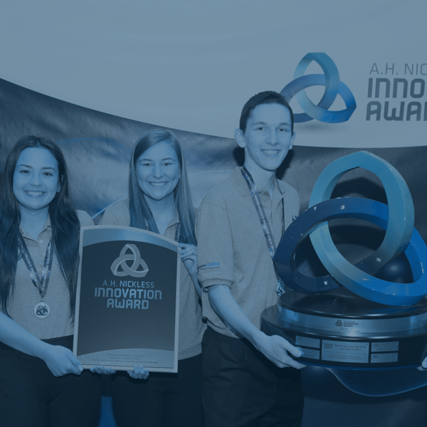 Students holding math innovation trophies from a competition