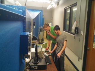 A set of students running the wind tunnel.