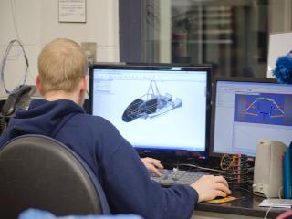 Student working on FSAE race car chassis design.