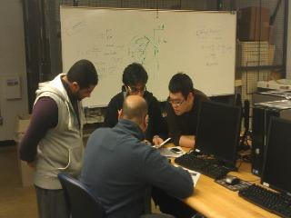 A group of students reviewing data for a fluids lab