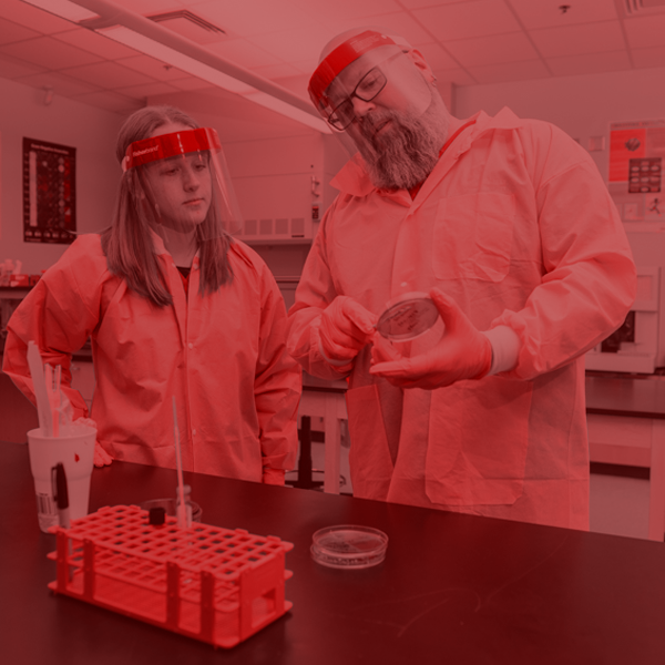 student working with instructor in a lab