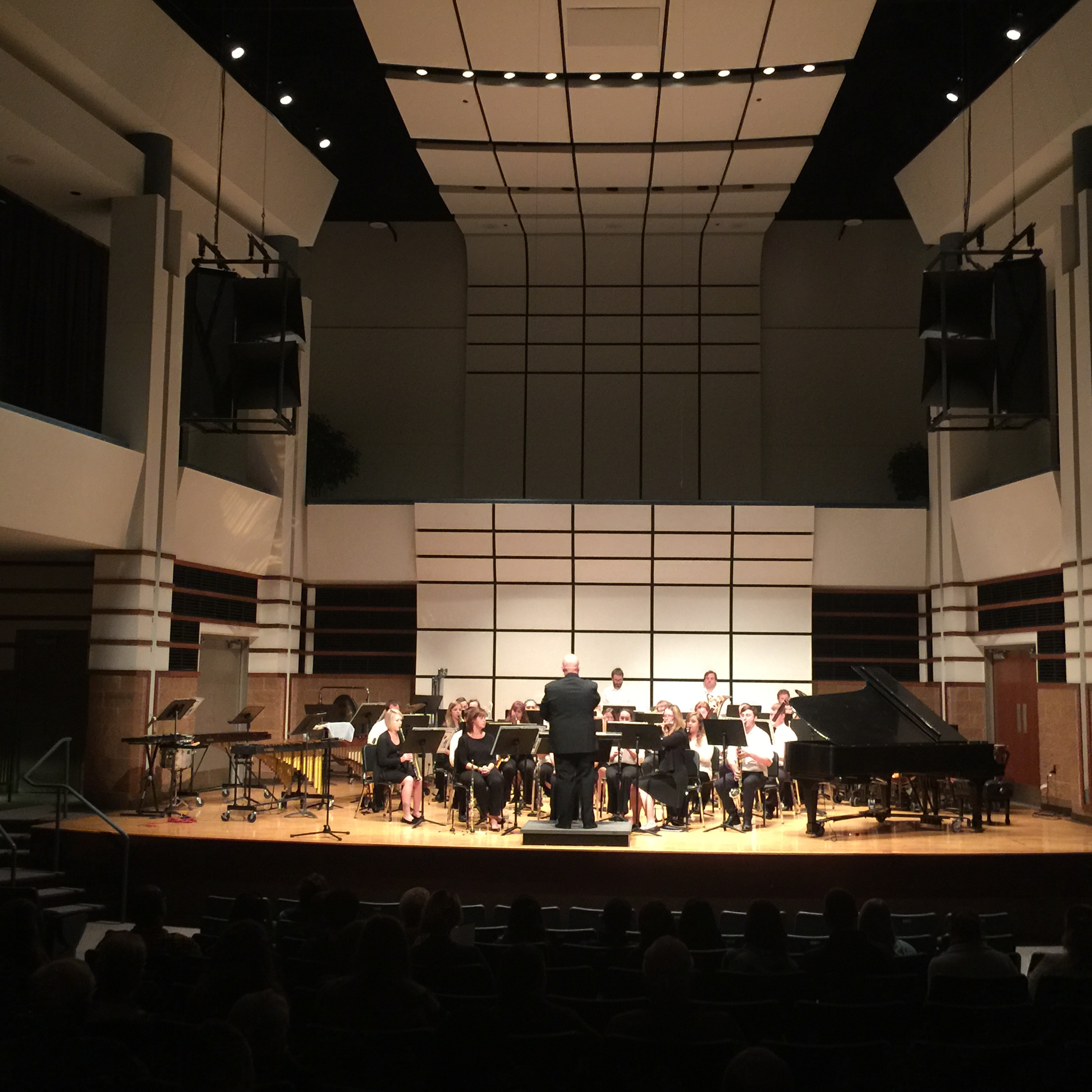 wind ensemble performing in the Rhea Miller Theatre