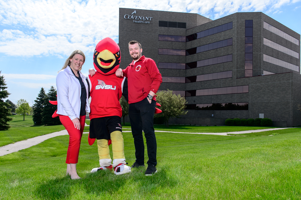 Riley Hupfer, assistant director for the Center for Community Engagement; Beth Alford, director of Military Student Affairs with Coop the cardinal