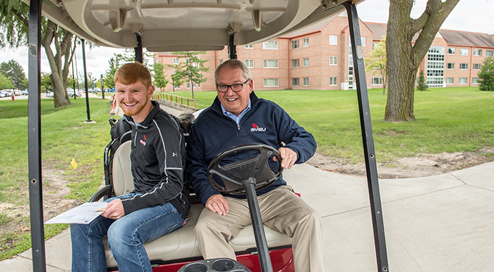 Move In, President Bachand with student Joshua Ames from Davison.