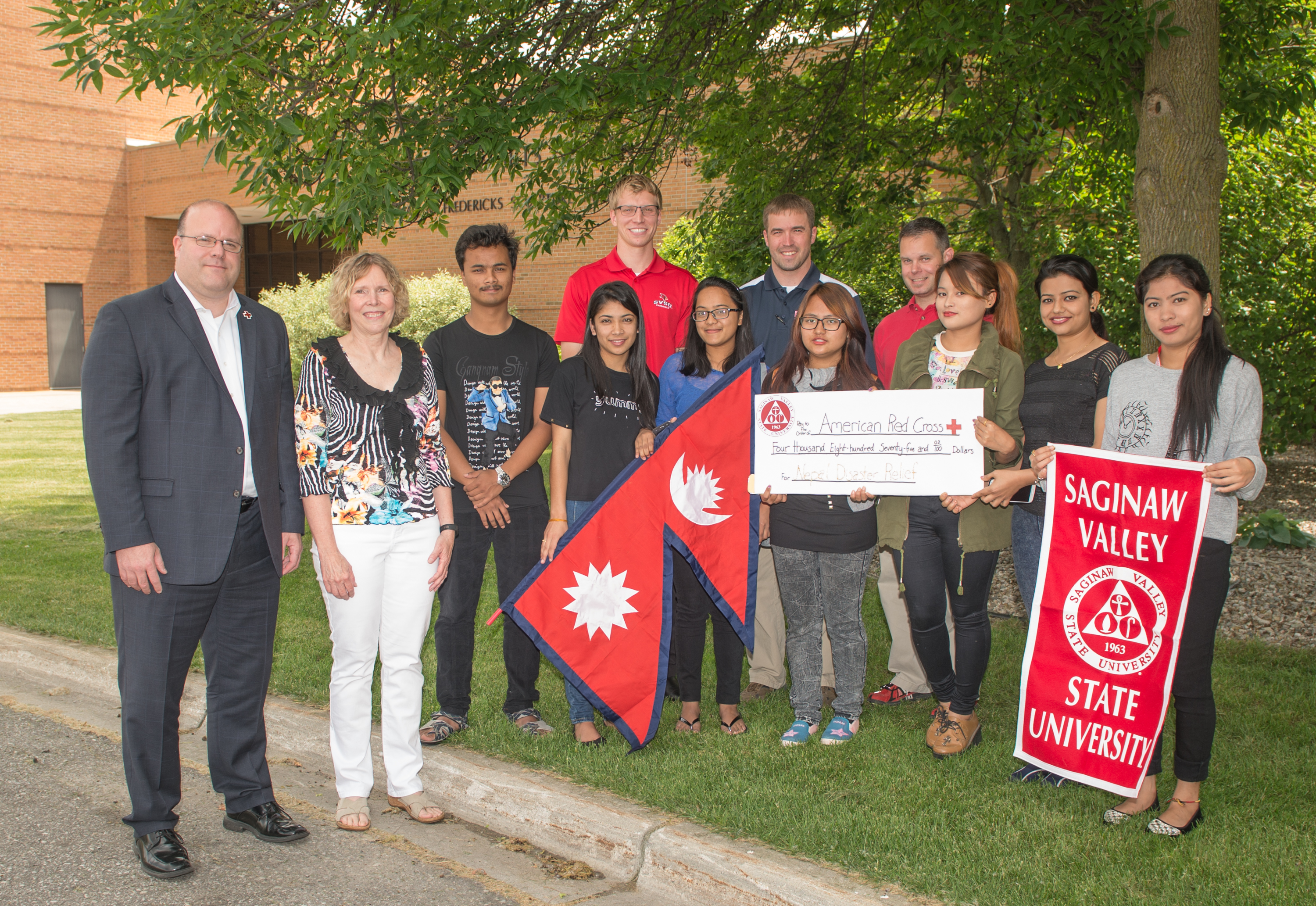 SVSU students and faculty give nearly $5,000 to East Central Bay Chapter of The American Red Cross for disaster relief in Nepal.