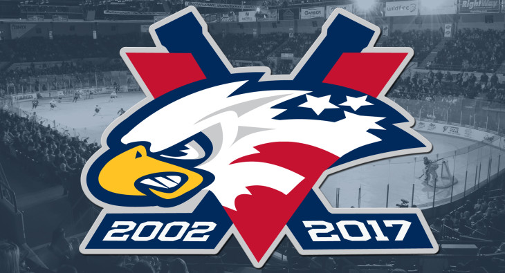 Logo for 15th anniversary season of Saginaw Spirit hockey team.  Eagle head logo with two crossed hockey sticks one has 2012 on stick blade, other has 2017.