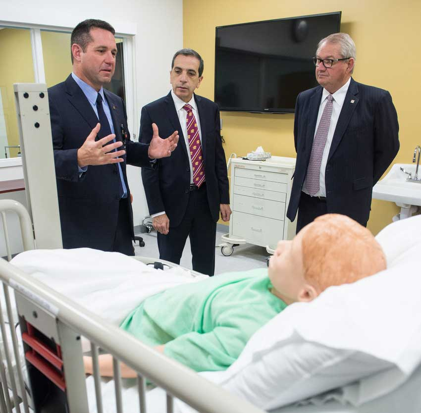 CMU College of Medicine Dean Dr. George E. Kikano, CMU President George E. Ross, and SVSU President Don Bachand tour the College of Medicine.