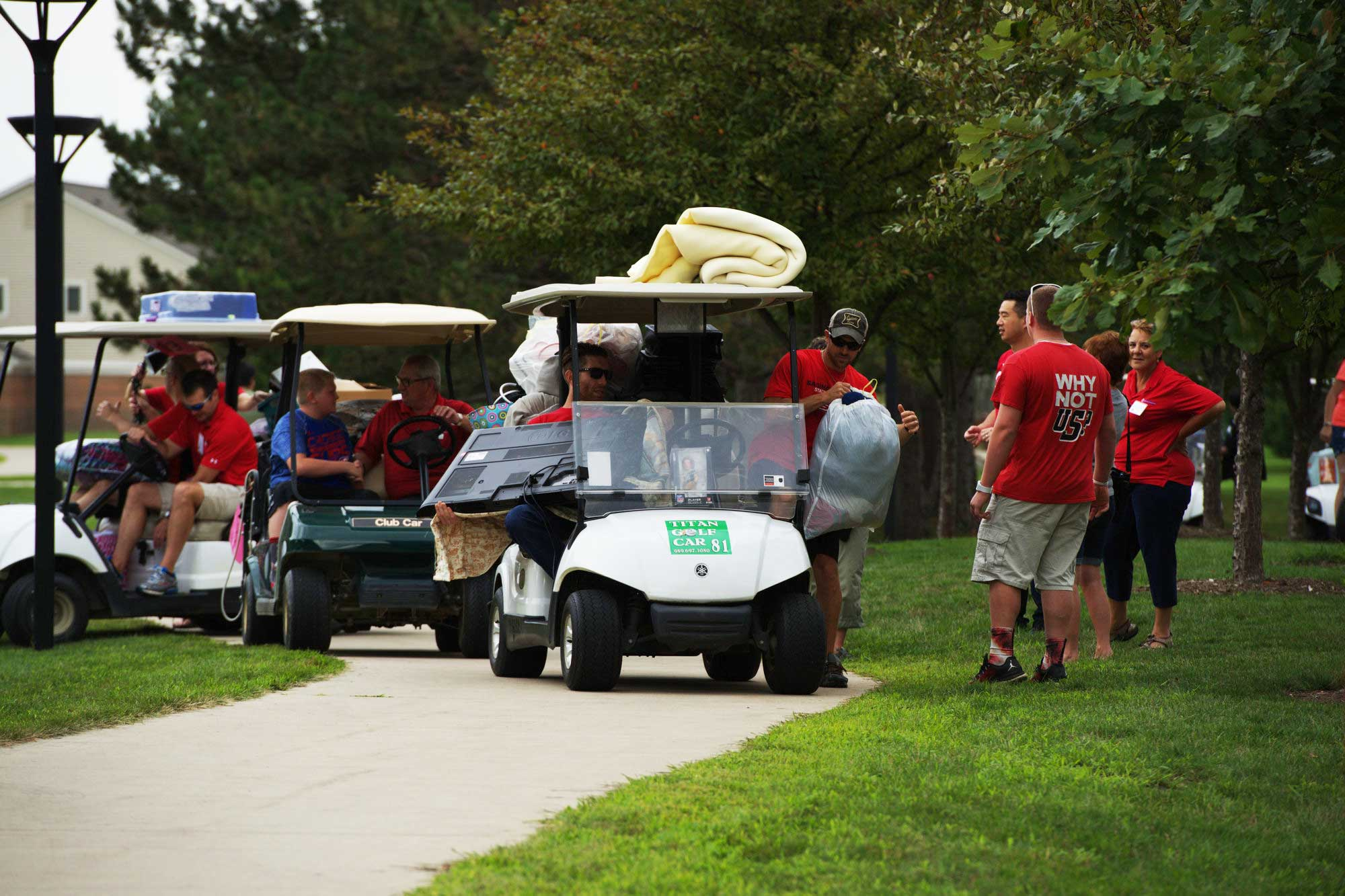Incoming freshmen move in putting personal belongings on golf carts.