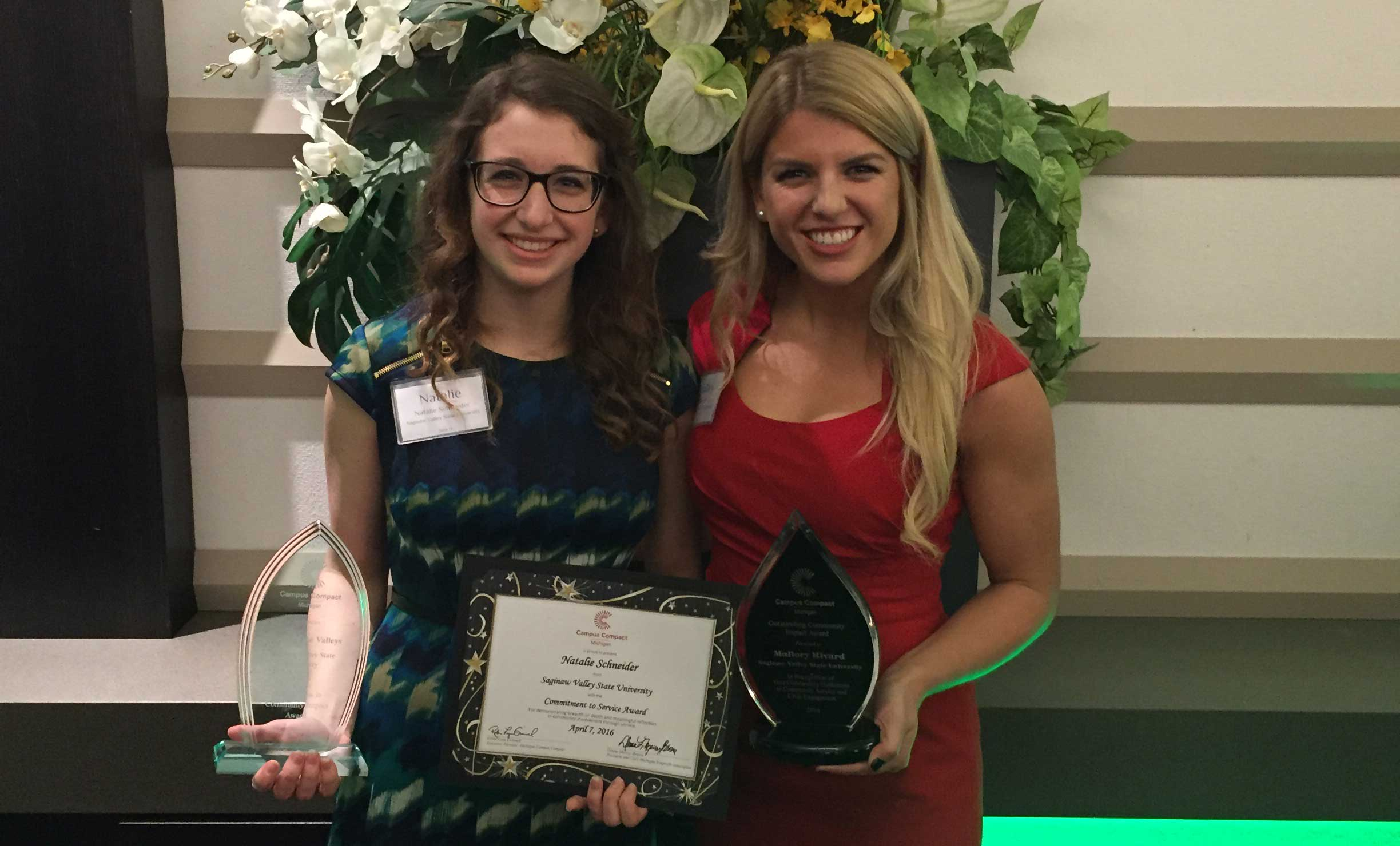 Natalie Schneider and Mallory Rivard were honored for their community-minded actions during the Michigan Campus Compact Awards Gala.