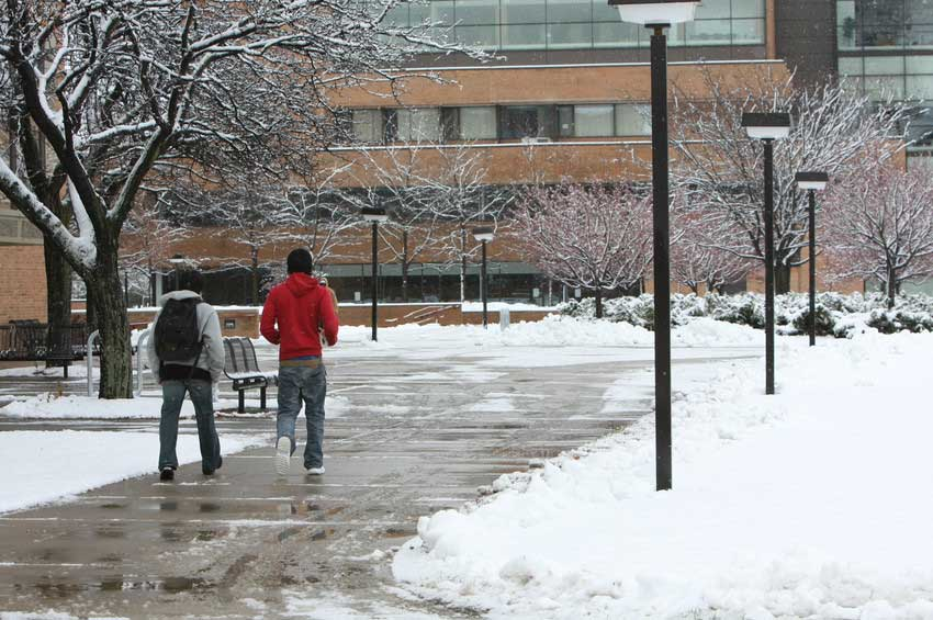 Winter snow with students in courtyard