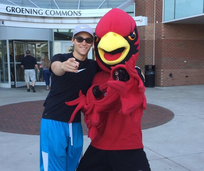 Student with Coop at Cardinal College Day