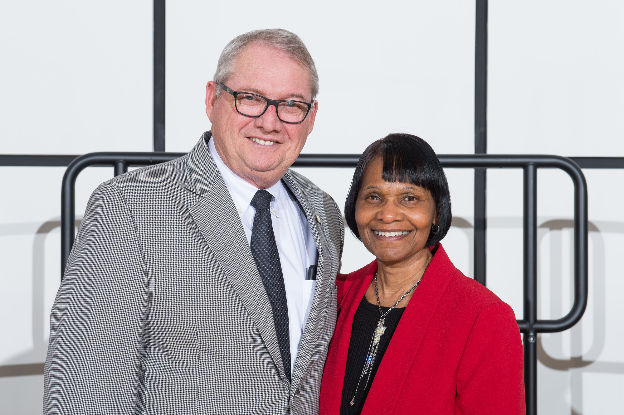 President Bachand with Debwin Williams, financial aid advisor.