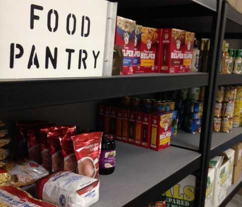 A food pantry with food items on shelves.