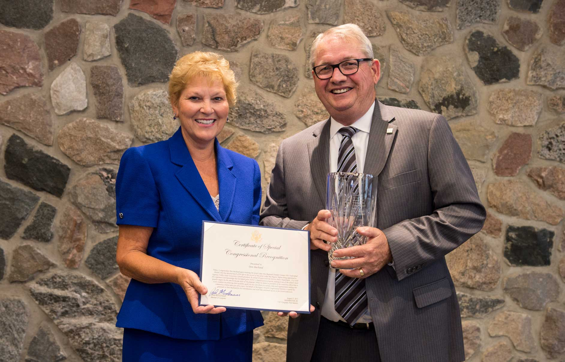 GLBR Regional Summit 2017: SVSU received award Don Bachand is pitured with Dr. Diane Postler-Slattery, president and CEO of MidMichigan Health.