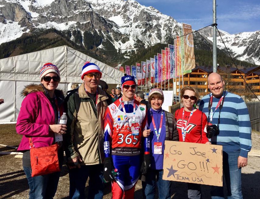 John Kaczynski, director of governmental affairs, with his family and his brother Joe, who has been competing at the Special Olympics World Games in Austria this week.