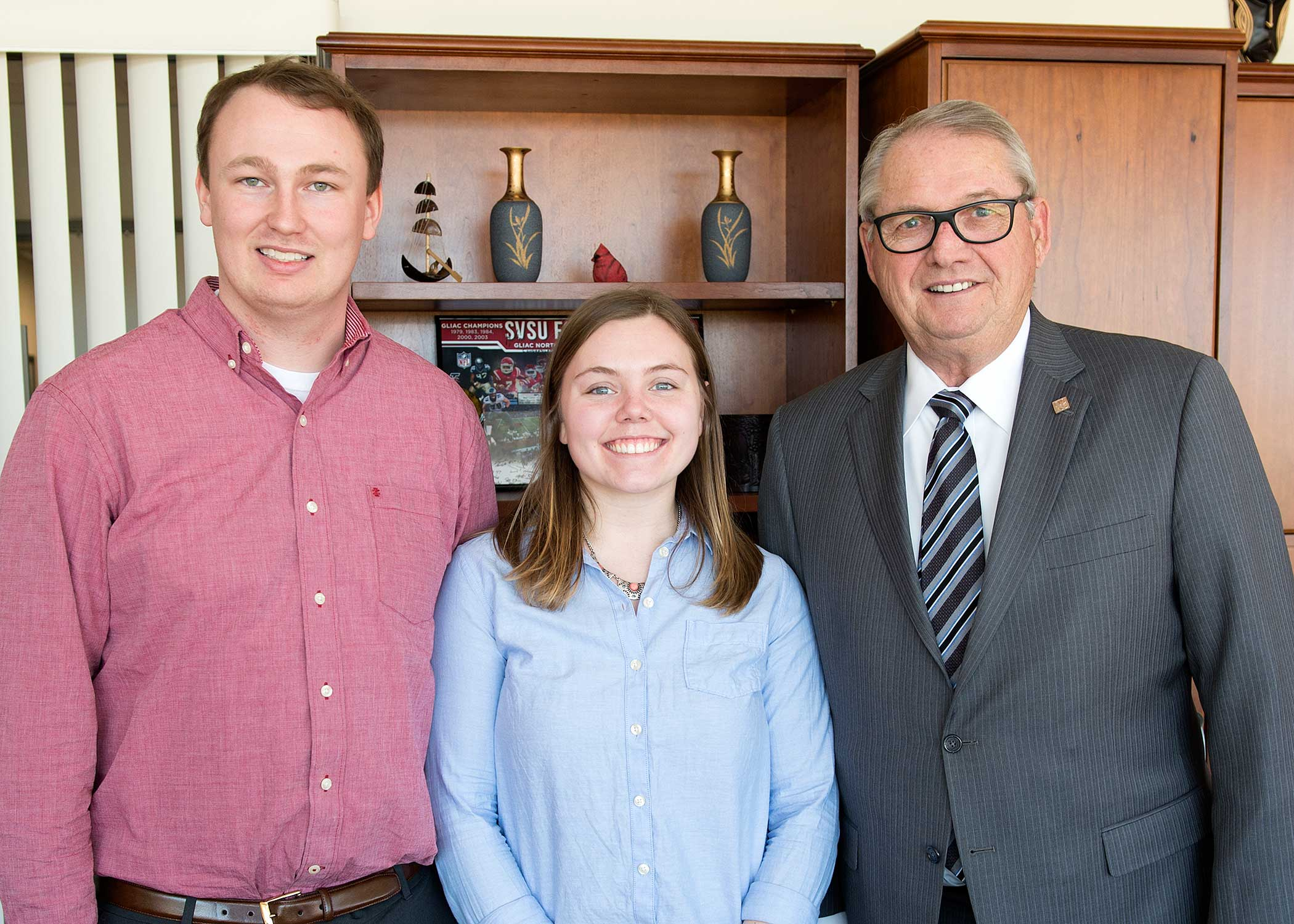 Cody McKay (Student Association president), Lauren Kreiss (Student Association president elect) and SVSU President Donald Bachand.