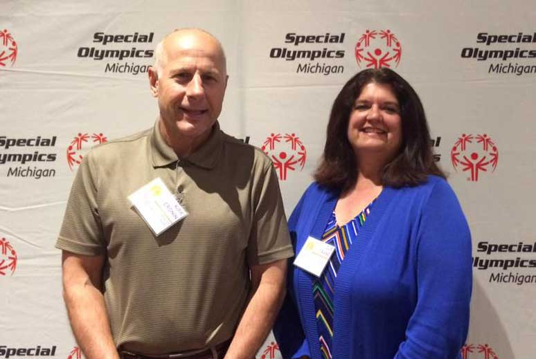 Sue Crane, budget director, was named the 2017 Midland Special Olympic-Area 30 Outstanding Coach of the Year. Pictured with Kirk Cronin 2017 Midland Special Olympic-Area 30 Volunteer of the Year.