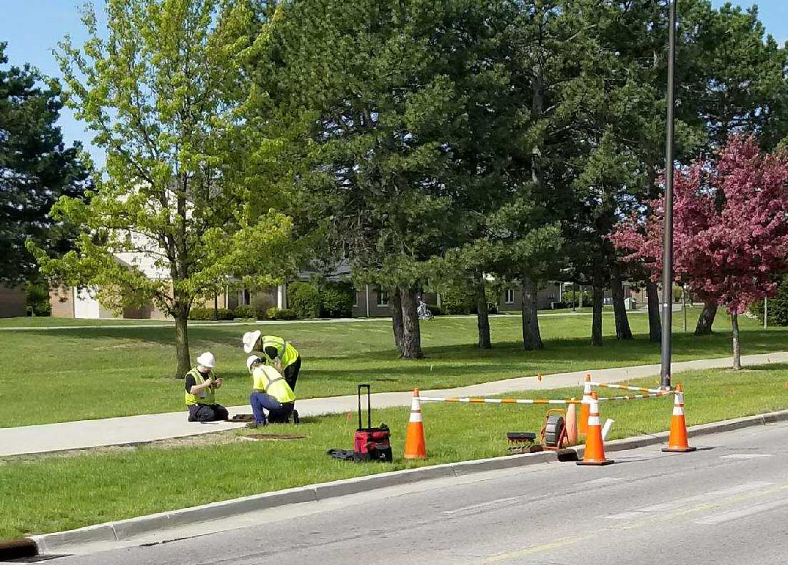 Consumers Energy crews work to replace gas lines.