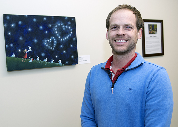 Faculty member and artist Matt Krease in front of his piece that was selected for the cover of the 2017 university holiday card.