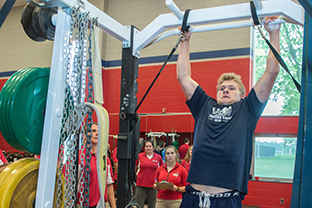 Members of Saginaw Spirit OHL hockey team training with members of SVSU Strength & Conditioning