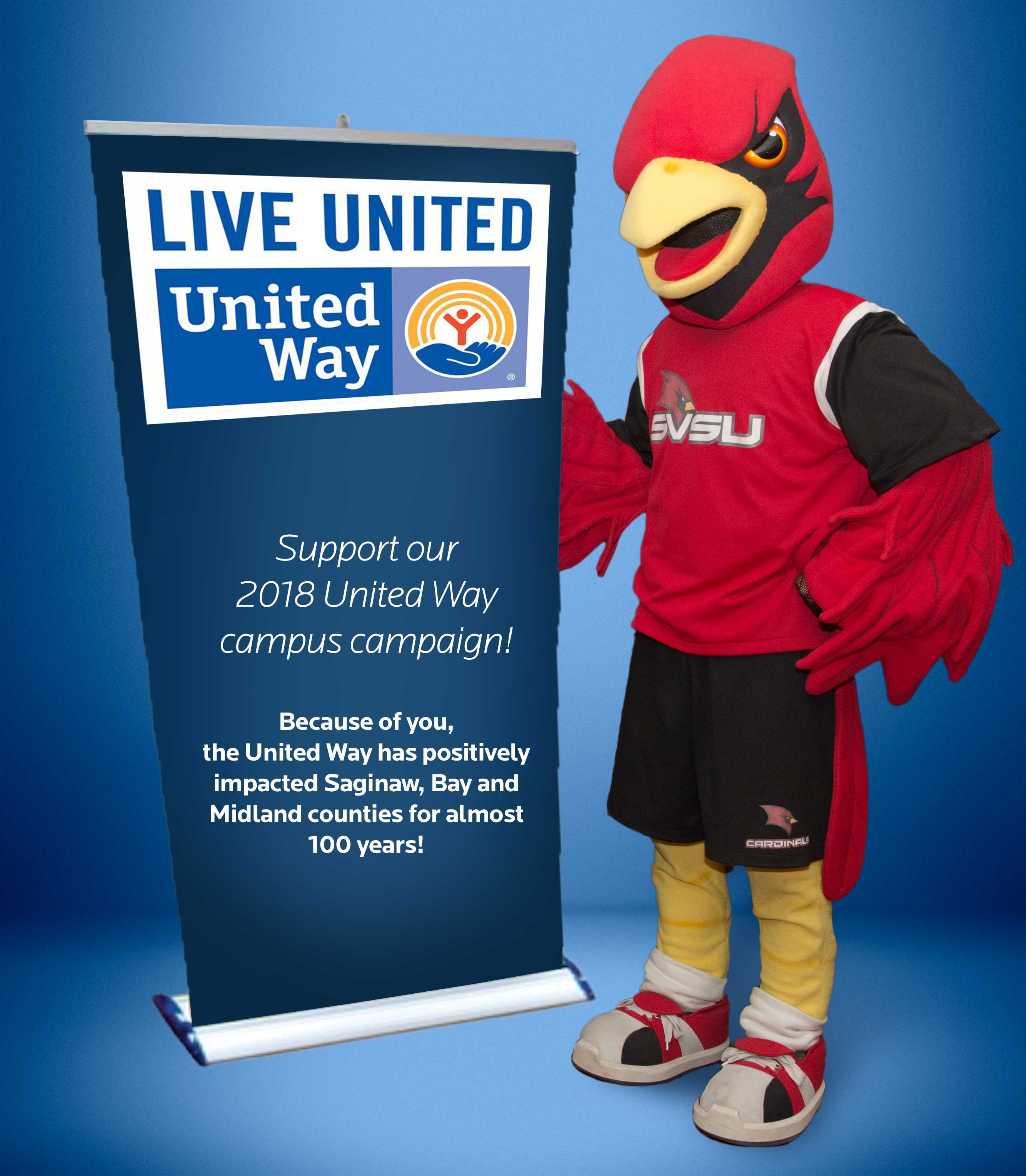Coop standing next to a banner with United Way logo, support our 2018 United Way campaign.