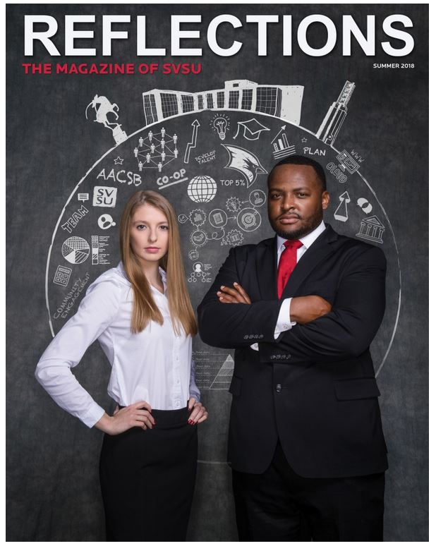 The cover of the Summer 2018 Reflections magazine. A business woman and a business man in front of chalkboard with drawings on it.
