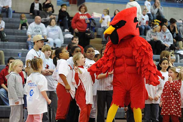 Coop at a basketball game with kids