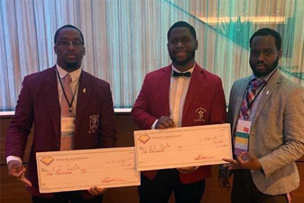 kappa alpha psi boys with big checks