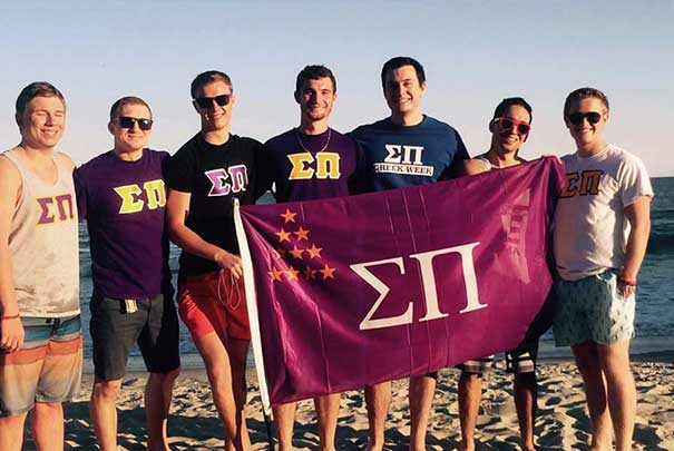 Sigma Pi group photo at the beach
