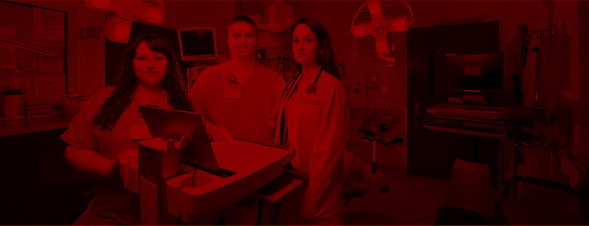 Medical scribes in Covenant Emergency room with red overlay.