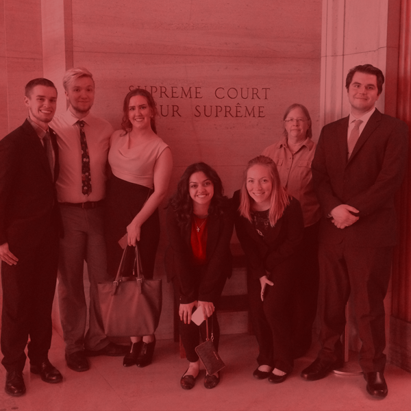 Group of Law Club students and advisor outside of the Supreme Court