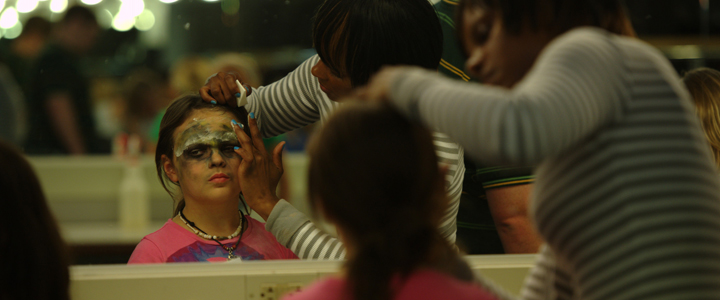Kids preparing makeup for a performance