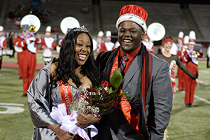 Photo of SVSU students Charnae Keith, left, and Brandon Jones immediately following their coronation as 2015 Homecoming king and queen. (Photo courtesy Mike Randolph, SVSU)